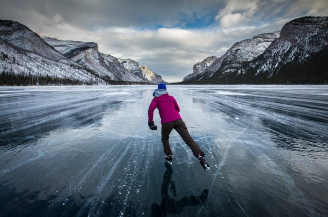 Skating on Lake Minnewanka. Photo by Paul Zizka Photography.